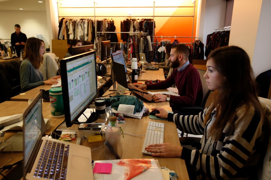 Assistant buyer Meghann Shean works with colleagues at Stitch Fix on Monday, Dec. 5, 2016, in San Francisco, Calif. Stitch Fix is an online fashion delivery service that ships personalized clothing to a customer's door. (Karl Mondon/Bay Area News Group)
