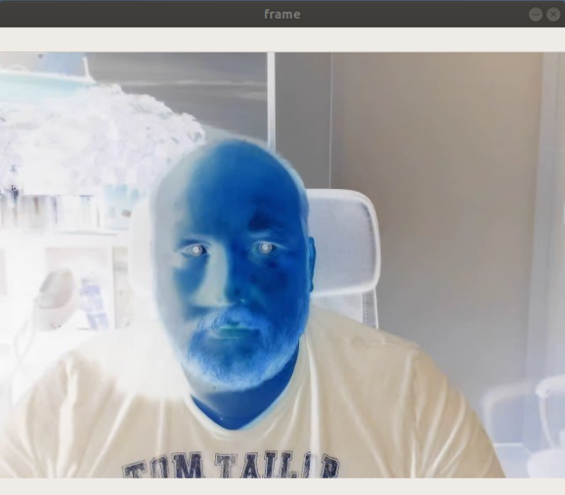 An image of the author recorded by a webcam and subsequently being color-inverted.